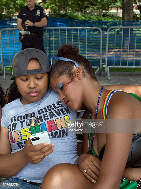 A lesbian couple embracing at Chelsea piers a popular hang out for the LGBT community and runaway teens during 2012 New York Gay Pride parade on June...