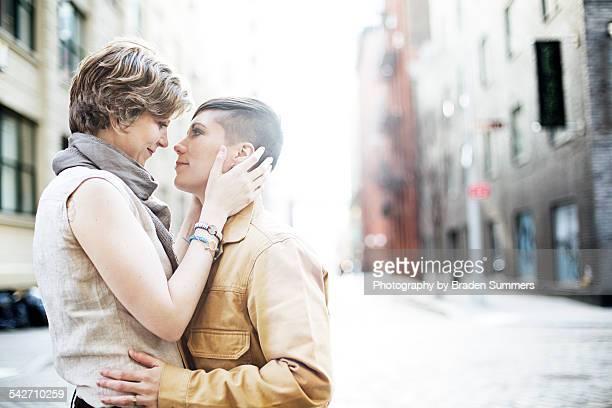 Lesbian couple embracing in Brooklyn.