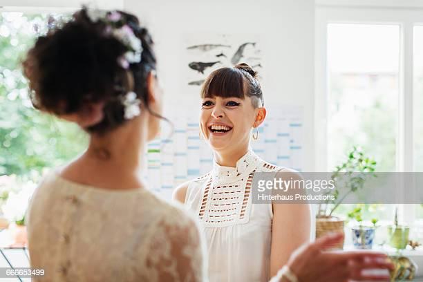 Lesbian couple getting ready for their wedding