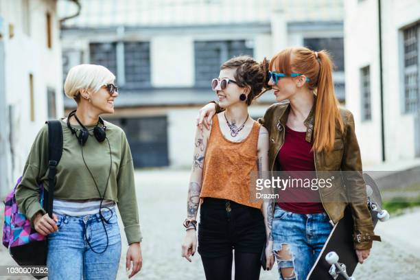 lesbian couple going out with friends - alternative lifestyle stock pictures, royalty-free photos & images