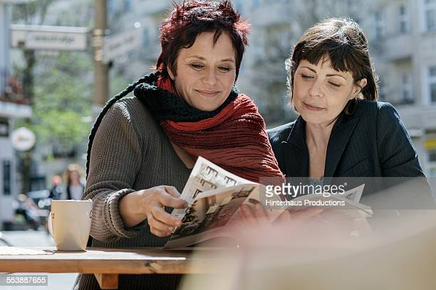 Lesbian Couple In A Cafe