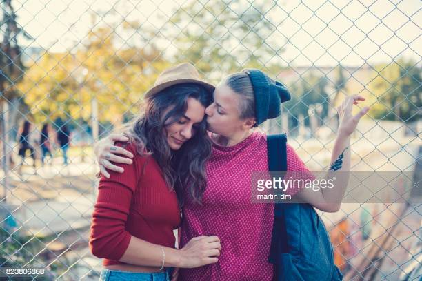 lesbian couple in love kissing outside - teenage couple stock photos and pictures