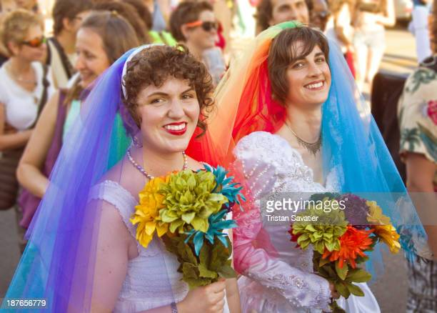 Lesbian couple in rainbow color wedding dresses, at the Gay Pride Festival in San Francisco. Other keywords: Gay rights, Gay marriage, LGBT, women,...