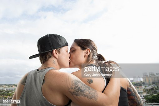 Lesbian couple kiss on balcony