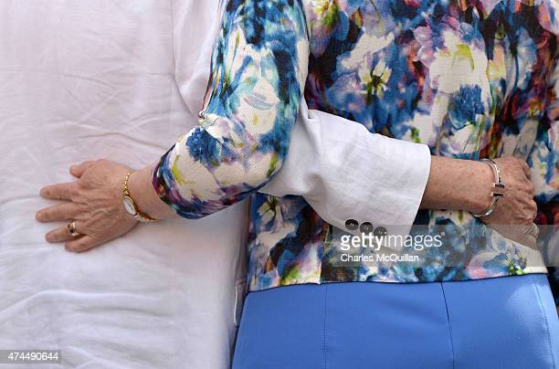 A lesbian couple link arms around their waists as thousands gather in Dublin Castle square awaiting the referendum vote outcome on May 23 2015 in...