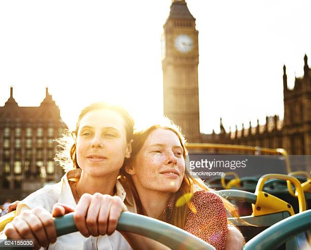 lesbian couple of tourist take a tour in london - double decker bus stock pictures, royalty-free photos & images