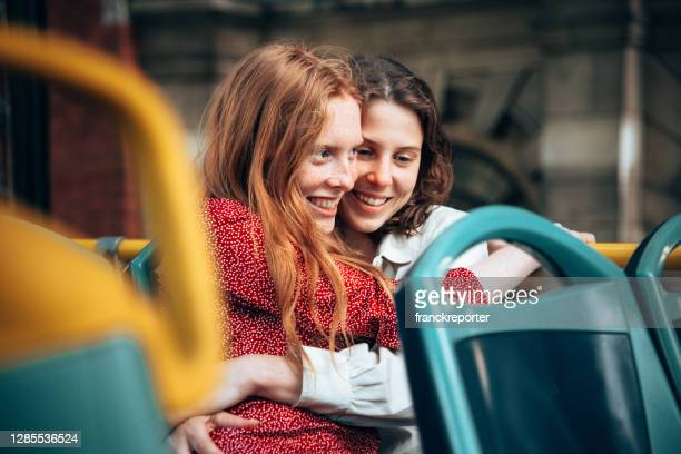 lesbian couple on the bus city tour in london - travel destinations stock pictures, royalty-free photos & images