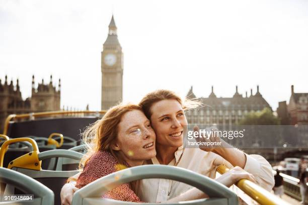 lesbian couple on the bus in london - bisexuality stock photos and pictures