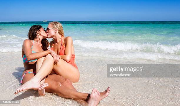 Lesbian couple on vacation at the beach in the Bahamas