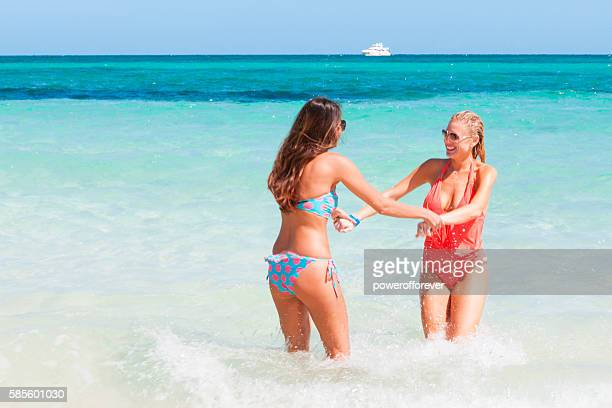 lesbian couple on vacation at the beach in the bahamas - grand bahama stock photos and pictures