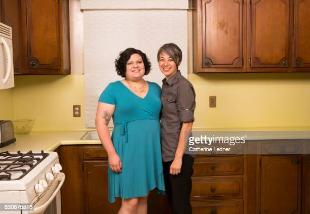 lesbian couple pose in their aunt's empty kitchen - monrovia california stock pictures, royalty-free photos & images