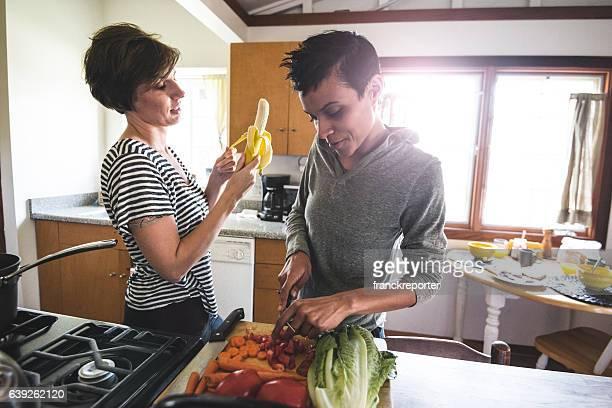 lesbian couple preparing food togetherness