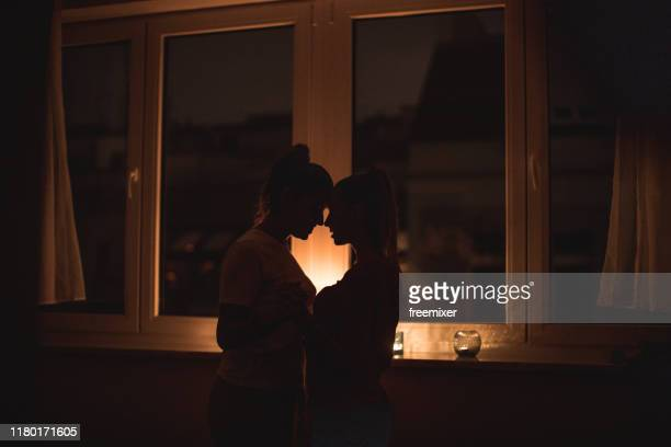 lesbian couple, romantic night with candles - romanticism stock pictures, royalty-free photos & images
