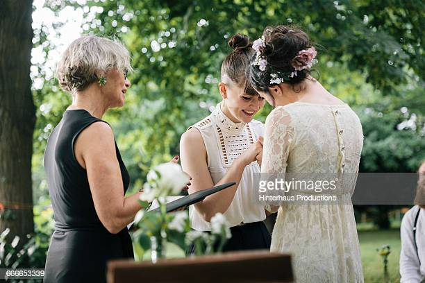 lesbian couple saying vows - civil partnership stock pictures, royalty-free photos & images