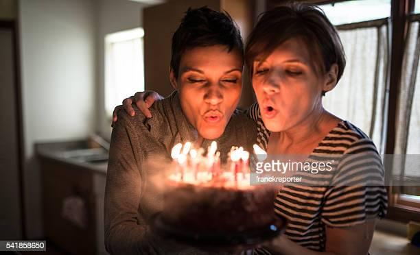 lesbian couple share the kiss for the birthday - birthday candles stock photos and pictures