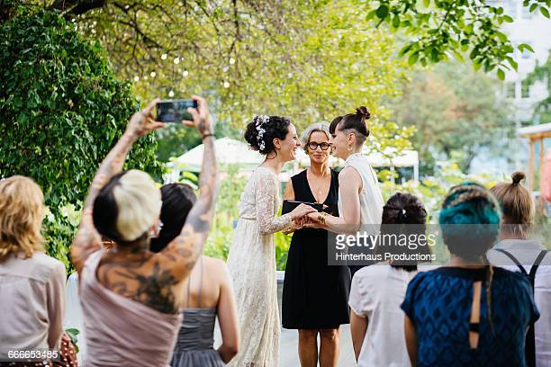 lesbian couple standing at the alter - wedding vows stock pictures, royalty-free photos & images