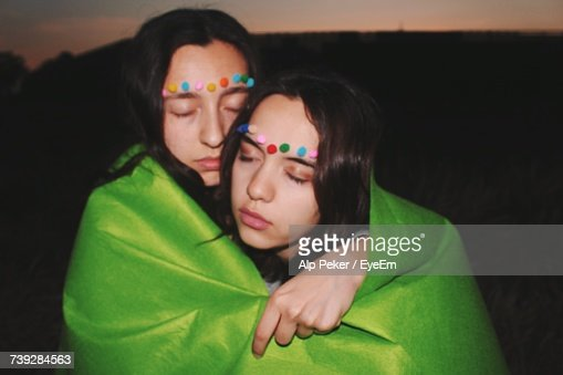Lesbian Couple Wearing Felt Make-Up Wrapped In Green Fabric