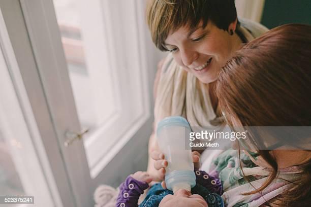 Lesbian couple with newborn child.