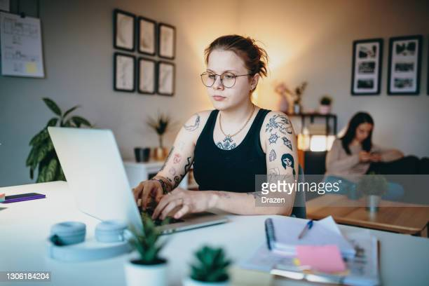 lesbian couple working from home on laptop - fiancé stock pictures, royalty-free photos & images