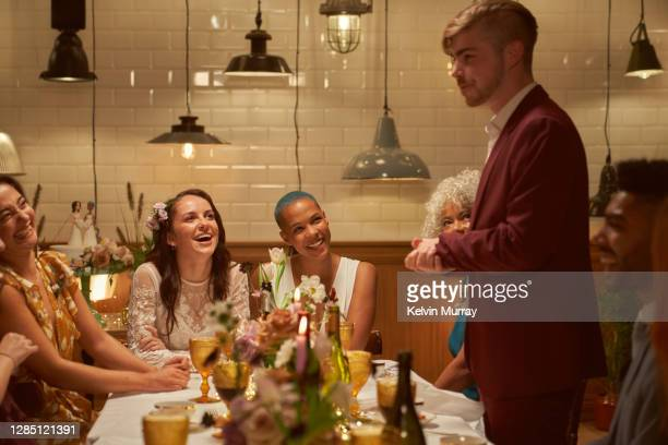 lesbian same sex wedding and friends having dinner party - politics and government stock pictures, royalty-free photos & images