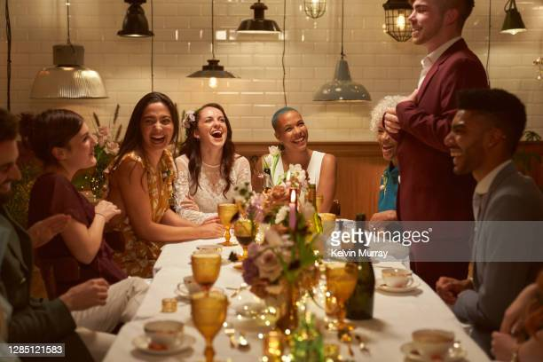 lesbian same sex wedding and friends having dinner party - {{relatedsearchurl(carousel.phrase)}} stock pictures, royalty-free photos & images