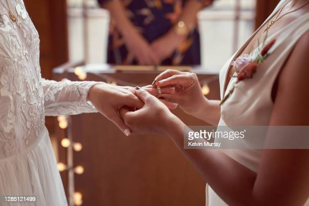 lesbian same sex wedding, ring exchange - human finger stock pictures, royalty-free photos & images