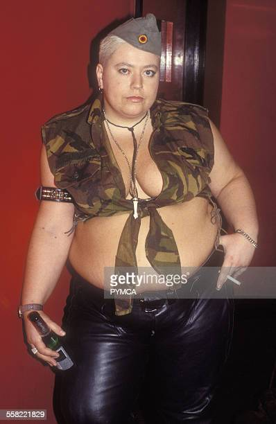 A Lesbian wearing leather trousers an army cap and a combat shirt Drag king a woman dressed as a man butch at Naive at Madame Jo Jos in Soho London...