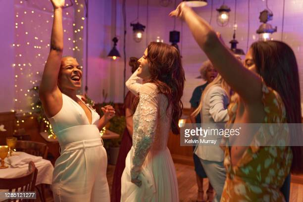 lesbian wedding and friends having dinner party - politics and government stock pictures, royalty-free photos & images
