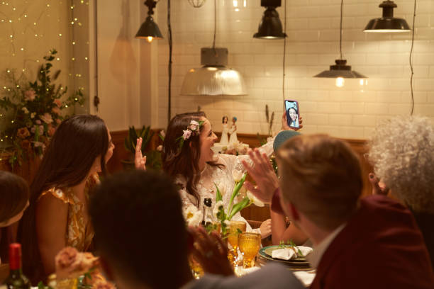 lesbian wedding party with a friend on a video call - wedding stock pictures, royalty-free photos & images