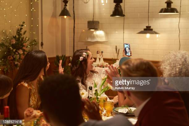 lesbian wedding party with a friend on a video call - politics and government stock pictures, royalty-free photos & images