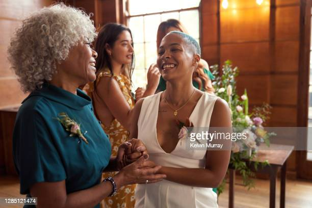 lesbian wedding with friends and parents - {{relatedsearchurl(carousel.phrase)}} stock pictures, royalty-free photos & images