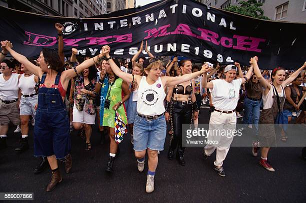 """Lesbians march in front of a """"International Dyke March"""" banner at a march commemorating the 25th anniversary of the Stonewall riots."""
