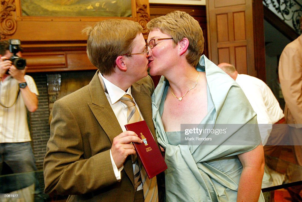 Lesbians Marion Huibrecht and Christel Verswyvelen celebrate their marriage June 6, 2003 in Antwerp, Belgium. Huibrecht and Verswyvelen became the first homosexual couple to marry in Belgium, celebrating 16 years of official partnership with wedding vows during their civil ceremony.