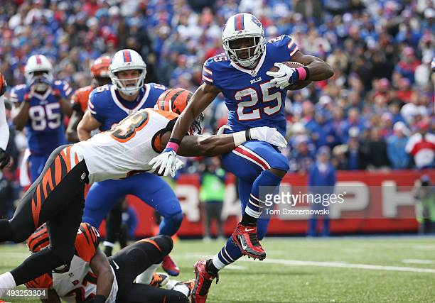 LeSean McCoy of the Buffalo Bills breaks a tackle by George Iloka of the Cincinnati Bengals during the first half at Ralph Wilson Stadium on October...