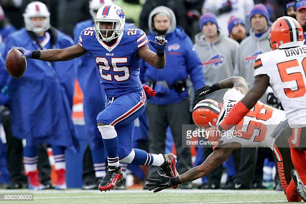 LeSean McCoy of the Buffalo Bills breaks away from Christian Kirksey of the Cleveland Browns during the first half at New Era Field on December 18...