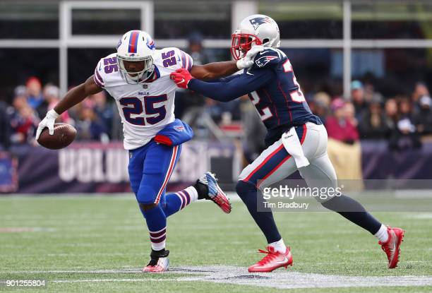 LeSean McCoy of the Buffalo Bills carries the ball against Devin McCourty of the New England Patriots at Gillette Stadium on December 24 2017 in...