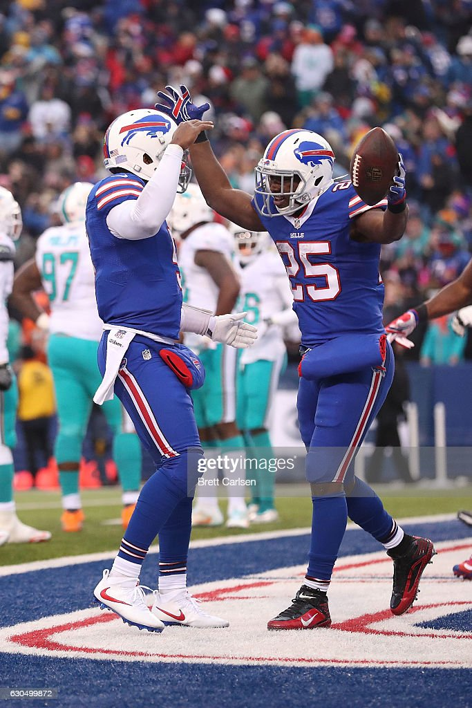 LeSean McCoy #25 of the Buffalo Bills celebrates his touchdown with Tyrod Taylor #5 of the Buffalo Bills against the Miami Dolphins during the second half at New Era Stadium on December 24, 2016 in Orchard Park, New York.