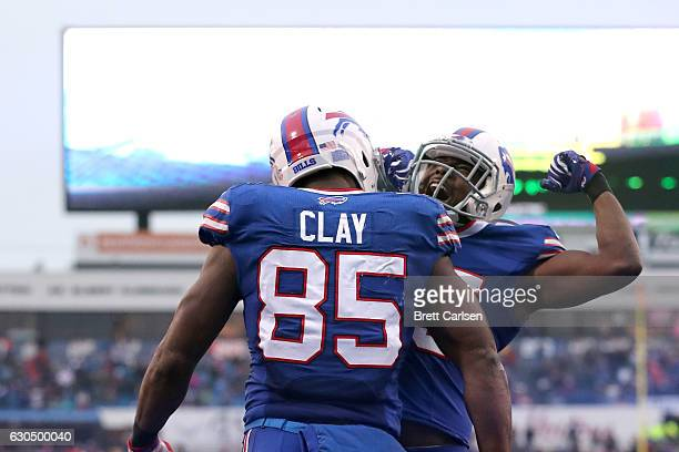 LeSean McCoy of the Buffalo Bills celebratesa a touchdown with Charles Clay of the Buffalo Bills during the second half against the Miami Dolphins at...