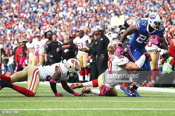 LeSean McCoy of the Buffalo Bills drags Nick Bellore of the San Francisco 49ers for extra yards during the second half at New Era Field on October 16...