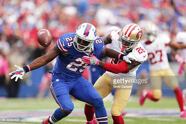 LeSean McCoy of the Buffalo Bills fumbles the ball but regains possesion as Tramaine Brock of the San Francisco 49ers defends during the second half...