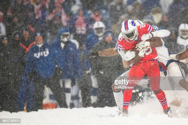 LeSean McCoy of the Buffalo Bills is brought down after running for positive yards during overtime against the Indianapolis Colts at New Era Field on...