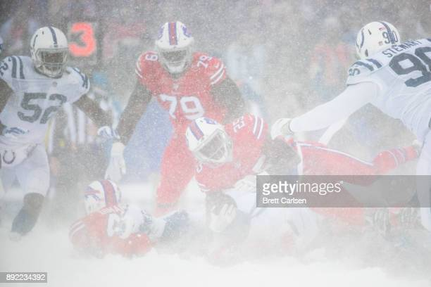 LeSean McCoy of the Buffalo Bills is brought down by members of the Indianapolis Colts during the third quarter at New Era Field on December 10 2017...