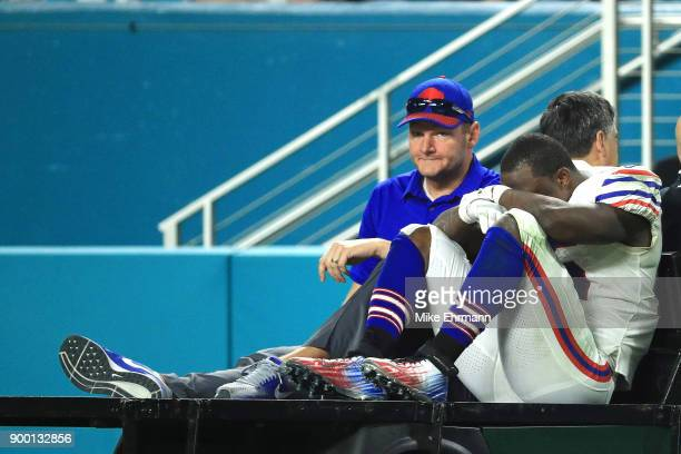 LeSean McCoy of the Buffalo Bills is carted off the field after an injury in the third quarter against the Miami Dolphins at Hard Rock Stadium on...