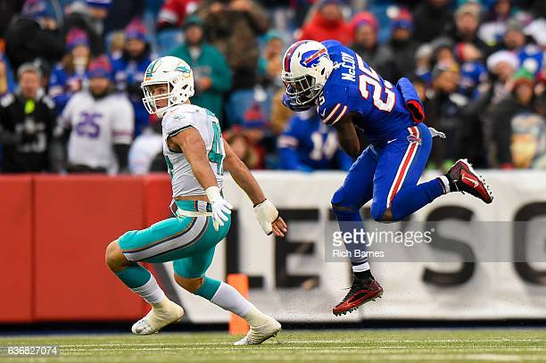 LeSean McCoy of the Buffalo Bills leaps to avoid the tackle attempt of Kiko Alonso of the Miami Dolphins during the third quarter at New Era Field on...