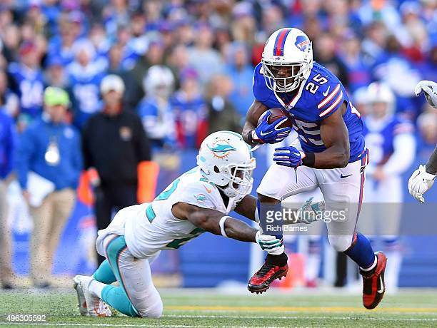 LeSean McCoy of the Buffalo Bills runs past Jamar Taylor of the Miami Dolphins during the second half at Ralph Wilson Stadium on November 8, 2015 in...