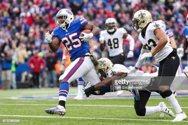 LeSean McCoy of the Buffalo Bills runs the ball as Rafael Bush of the New Orleans Saints and Marshon Lattimore of the New Orleans Saints attempt to...