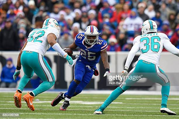 LeSean McCoy of the Buffalo Bills runs the ball as Spencer Paysinger of the Miami Dolphins and Kenyan Drake of the Miami Dolphins pursue the play...