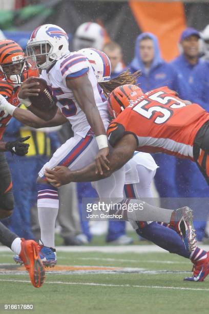 LeSean McCoy of the Buffalo Bills runs the football up field against Vontaze Burfict of the Cincinnati Bengals during their game at Paul Brown...