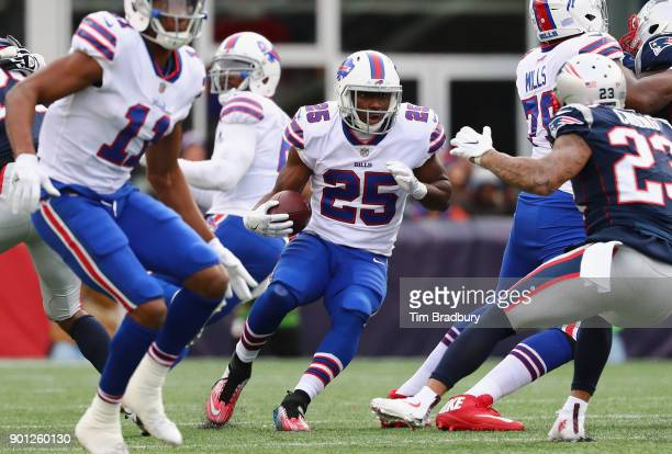 LeSean McCoy of the Buffalo Bills runs with the ball against the New England Patriots at Gillette Stadium on December 24 2017 in Foxboro Massachusetts