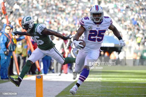 LeSean McCoy of the Buffalo Bills scores a first quarter rushing touchdown past Marcus Maye of the New York Jets at MetLife Stadium on November 11...